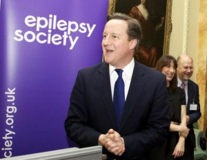 All smiles for the camera has he plots to cut the benefits of those with epilepsy